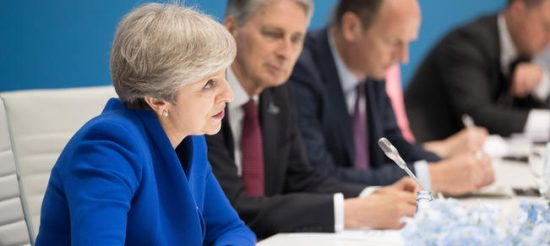 Prime Minister Theresa May speaks to Chinese President Xi Jinping sat opposite her as they hold a bilateral meeting during the G20 summit in Hamburg, Germany. (Matt Cardy/PA Wire)